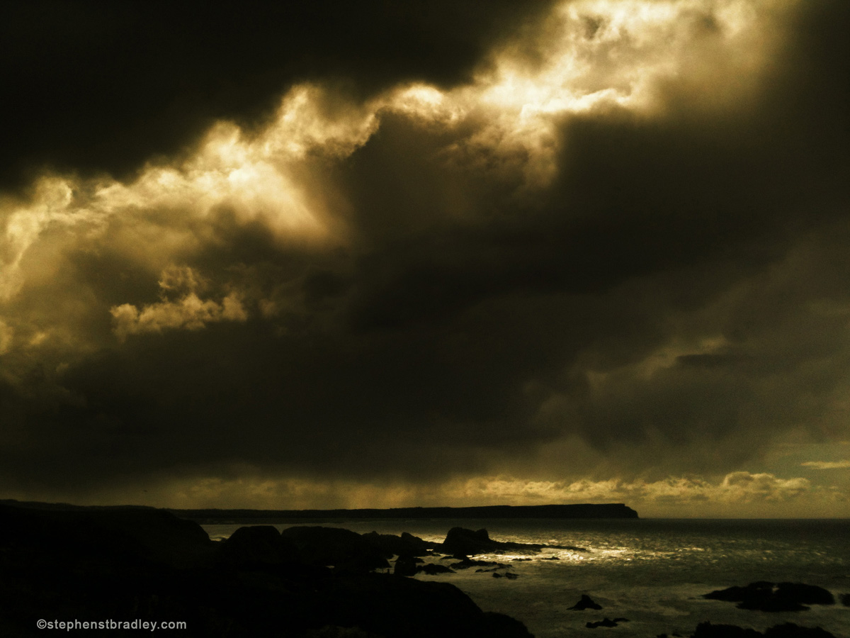 Commercial Photographer Atlanta landscape photo of storm clouds near Ballintoy, Northern Ireland - photo 2413 by Stephen Bradley photographer.