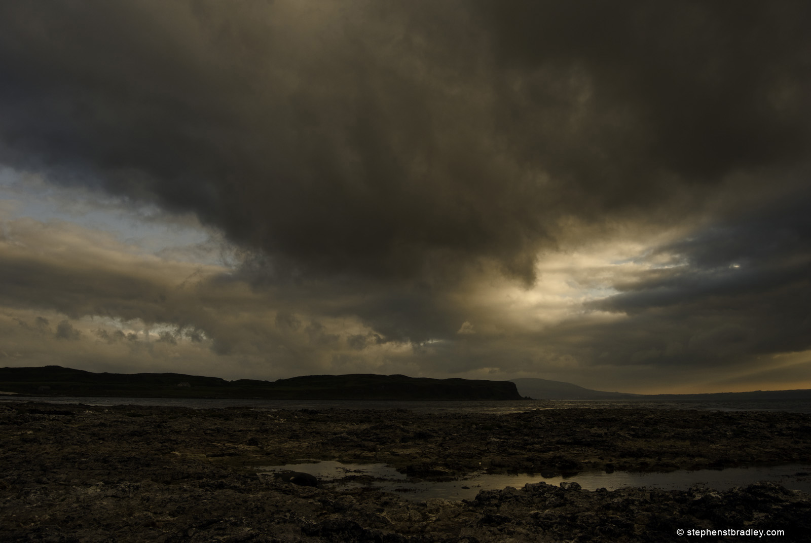 Rathlin Island Northern Ireland, showing the south peninsula photographed from Church Bay at sunset by landscape photographer Stephen S T Bradley - image 4075.