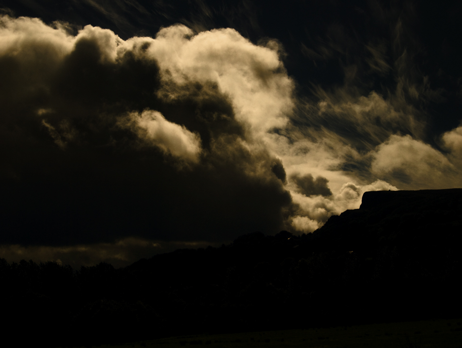 Landscape photograph of storm clouds over Cavehill Belfast, Northern Ireland - photo icon.