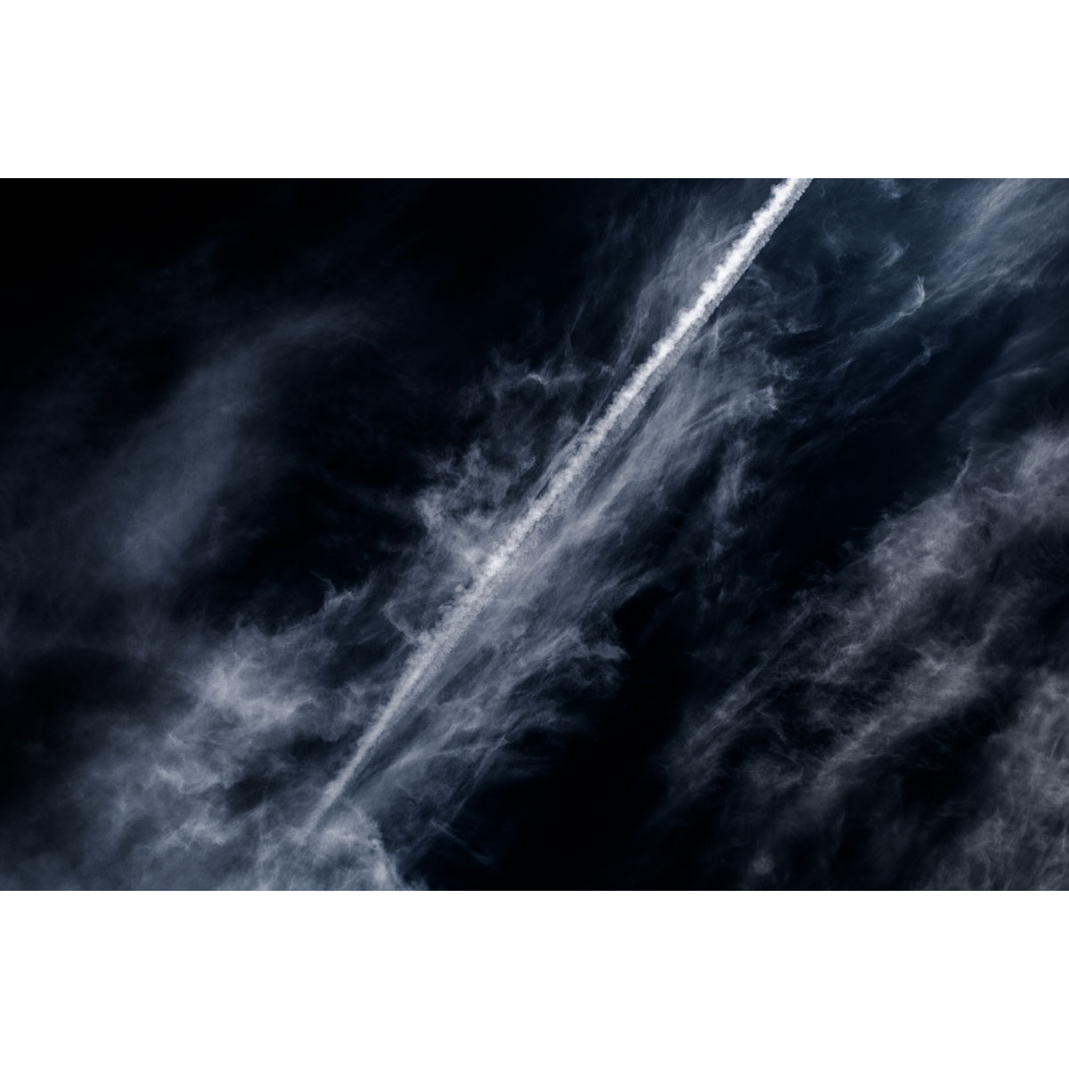 Cutting through the dross - an airliner's vapour trail comes to rest, before merging with clouds above Newtownabbey, Northern Ireland, by Stephen S T Bradley