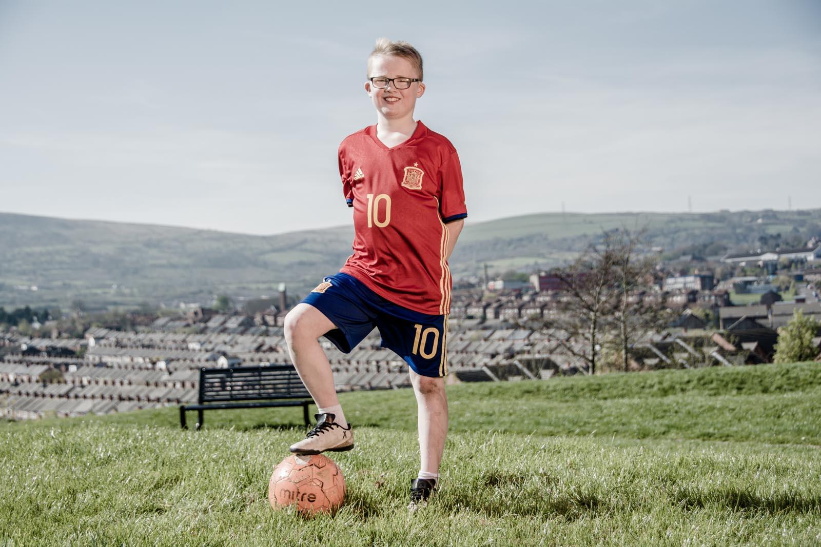 Boy wearing Spain football kit in park - photo 5343 by Stephen S T Bradley photographer Dublin and Belfast, Ireland