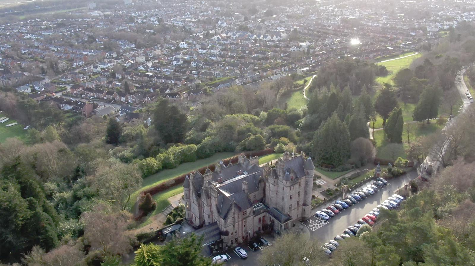 Aerial drone photography and video production services Dublin and Ireland portfolio - changing seasons in one video of Belfast Castle, Northern Ireland, video screenshot 3