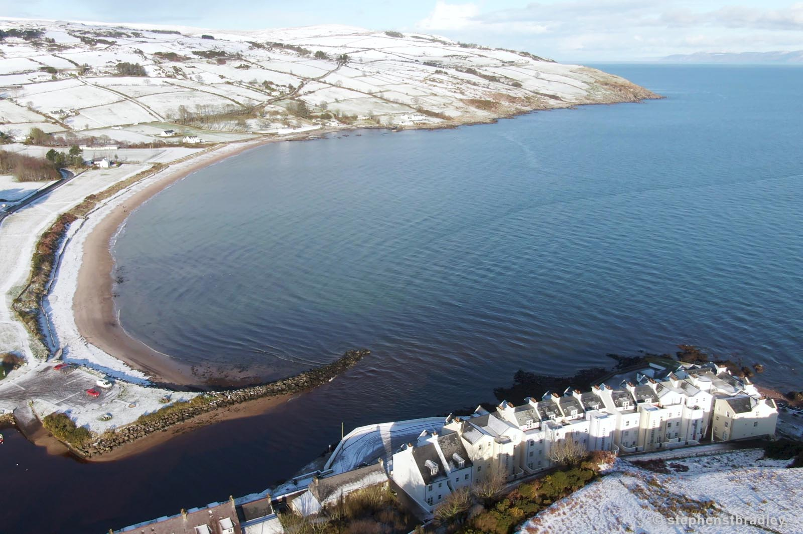 Aerial drone photography and video production services Dublin and Ireland portfolio - Cushendun village under snow in winter, video screenshot 4