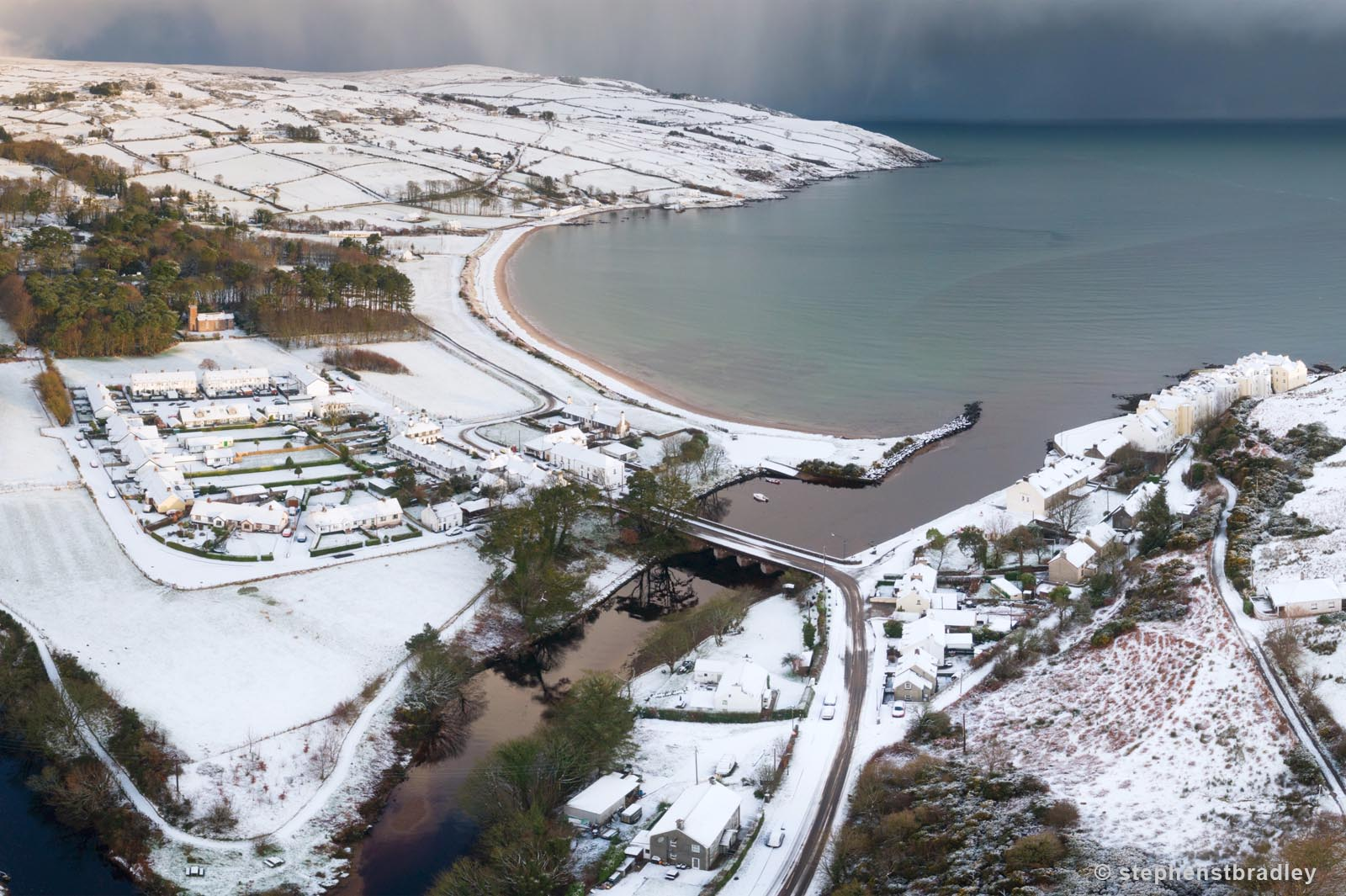 Aerial drone photography and video production services Dublin and Ireland portfolio - Cushendun village under snow in winter, video screenshot 6